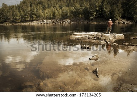 A fisherman on shore in the good ole days. - stock photo
