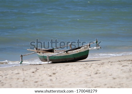 A fisherman's boat or dhow or indigenous canoe in Northern Mozambique city of Pemba. - stock photo