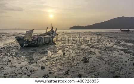 A fishermen's boat by the beach at Hammers Bay, Penang, Malaysia.