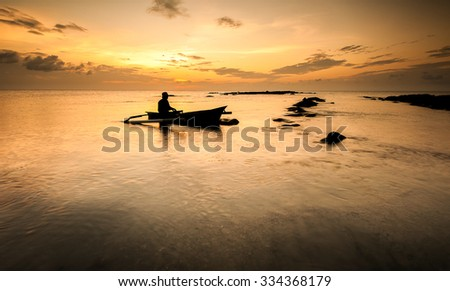 a fishing boat back home after tiring day - stock photo