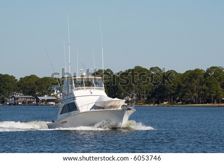A fishing boat in the bay. - stock photo