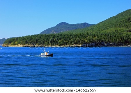 A fishing boat out on the Puget Sound, Washington, USA. - stock photo
