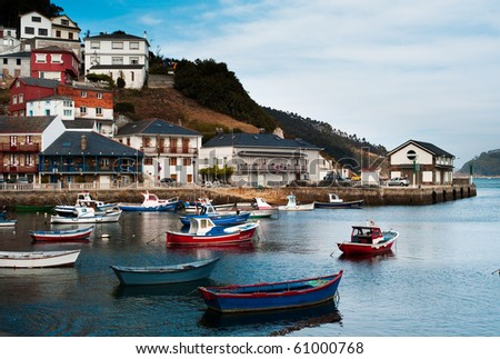 A fishing port with harbor and a small village. - stock photo