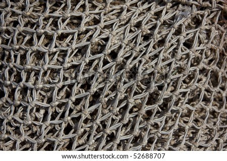 a fishnet in detail - stock photo