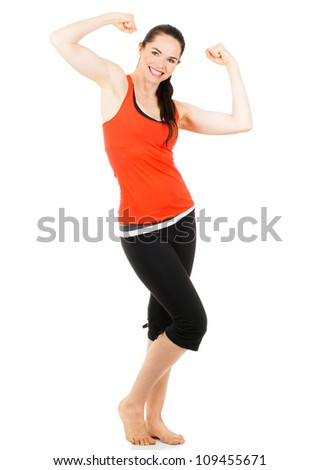 A fit beautiful sporty young woman flexing muscles on both her arms. Isolated on white. - stock photo