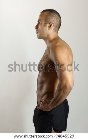 A fit Latin Guy in Profile - stock photo