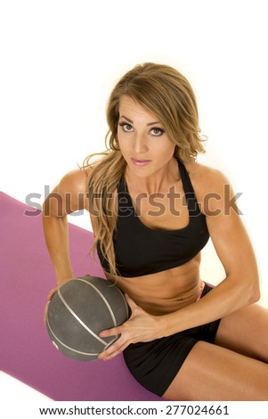 A fit woman working out her abs by using a medicine ball. - stock photo