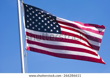 A Flag lit by the sun. - stock photo