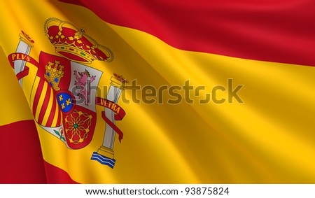 A flag of Spain in the wind - stock photo