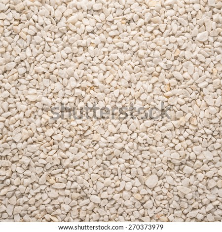 A flat background of small grey pebbles for background or texture  - stock photo