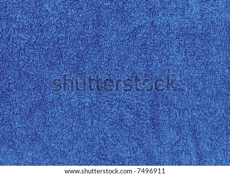 A flat texture of a fuzzy blue cloth towel, suitable for backgrounds - stock photo