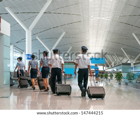 A Flight Crew Walking in the Airport - stock photo