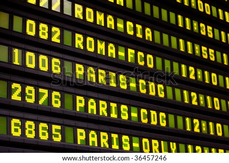 A Flight Information Board in the Airport - stock photo