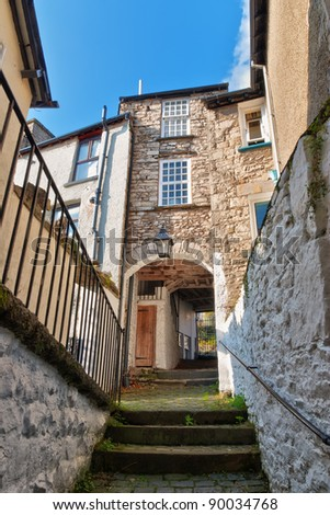 A flight of steps and an archway in Kendal, Cumbria, England. - stock photo