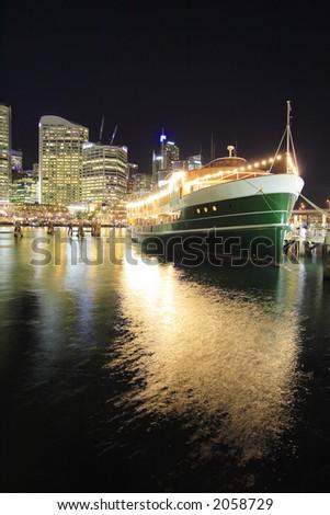A floating restaurant docked at Darling Harbor, Sydney at night - stock photo