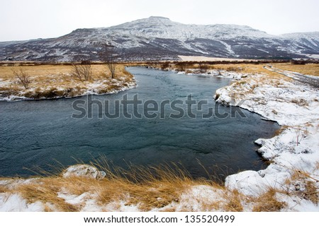 A floating river in the winter near Geysir in Iceland - stock photo
