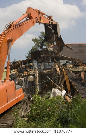 A flood damaged home in the Lakeview section of New Orleans is demolished - stock photo