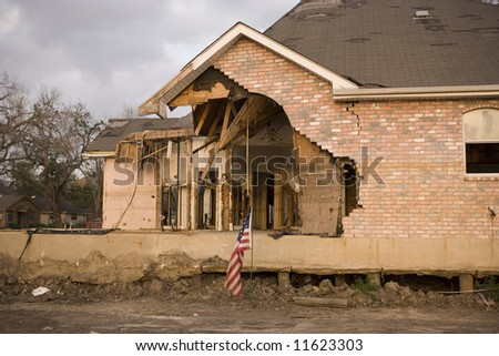 A flood damaged home in the Lakeview section of New Orleans. This home sits half a block from where the levies failed. - stock photo
