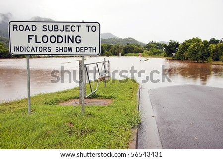A flooded road after heavy rains - stock photo