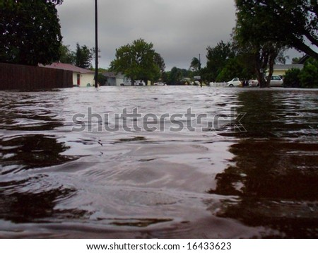 A flooded street after a tropical storm with 25 inches of rain - stock photo