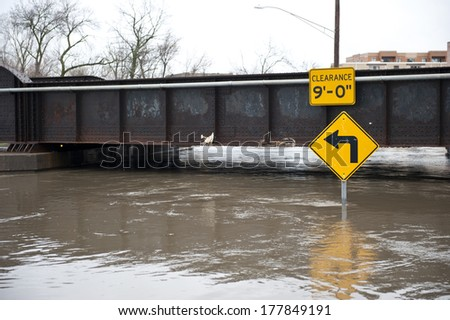 "A flooded 9"" underpass on a cloudy day in the Chicago area. - stock photo"