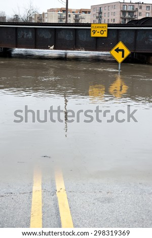 A flooded 9 underpass on a cloudy day in the Chicago area. - stock photo