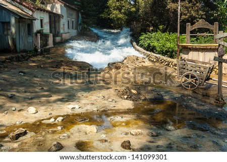 a flooding, maybe the consequence of torrential rains, occurring in a small village - stock photo