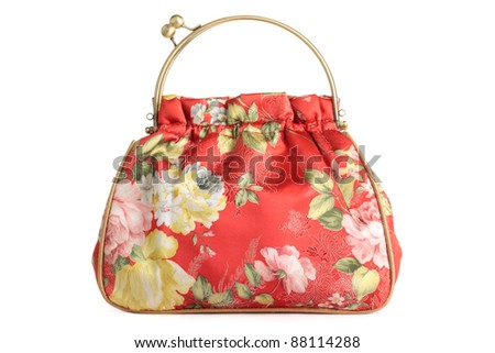 A floral pattern womens hand bag, isolated on a white background.