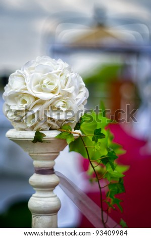 A floral wedding decoration at red carpet to gazebo