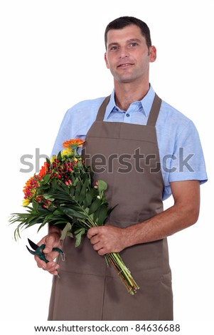 a florist with a flowers bouquet - stock photo