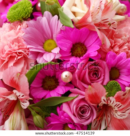 A flower bouquet with a lot of different flowers - stock photo