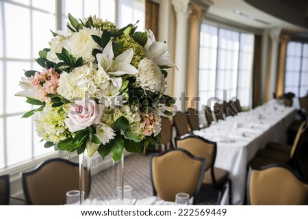 a flower centerpiece on a table  - stock photo