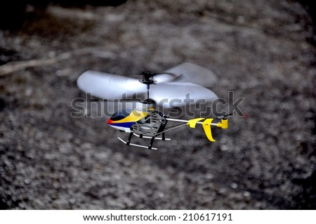 A flying helicopter toy  - stock photo