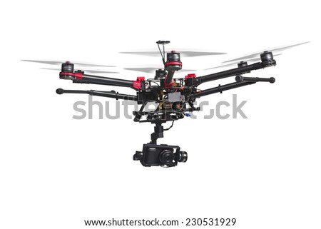 A flying helicopter with rised landing gears and a camera isolated on white background. Includes clipping path. - stock photo