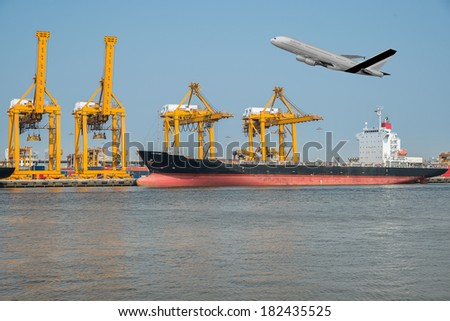 a flying plane  and a freight ship on transport background - stock photo