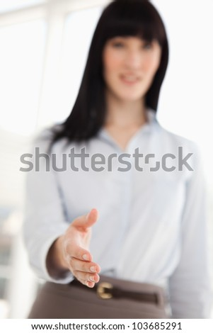 A focused shot of the woman's hand as she offers it to shake - stock photo