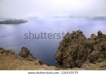 A fog view of crater lake - stock photo