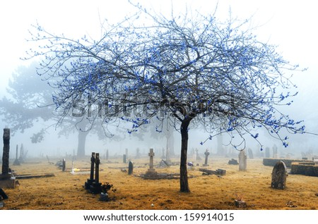 A foggy cemetery in infrared - stock photo