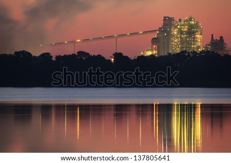 A Foggy Orange Dawn at the Electric Power Plant - stock photo