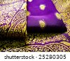 A folded purple saree with beautiful floral embroidery - stock photo