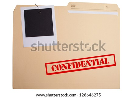 "A folder labeled ""CONFIDENTIAL"" with a blank clipped to it - stock photo"