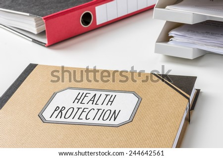 A folder with the label Health protection - stock photo