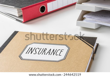A folder with the label Insurance - stock photo
