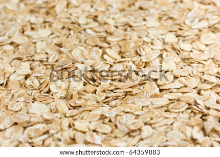 A food background of rolled oats - stock photo