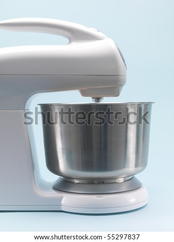 A food mixer isolated against a blue background - stock photo