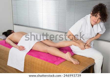 A foot massage, spa foot oil treatment - stock photo