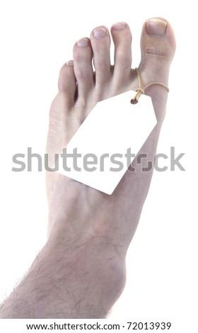 A foot with a toe tag isolated on white