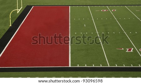 A football field with a red endzone - stock photo