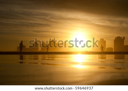 A football game on the beach at sunset. Uruguay. Punta Del Este - stock photo