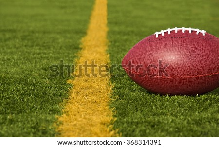 A football lies just short of the goal line. - stock photo
